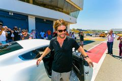 Jay Kay of Jamiroquai driving an Aston Martin on Kyalami Race Track royalty free stock image