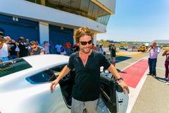 Jay Kay jedzie Aston Martin na Kyalami Biegowym śladzie Jamiroquai obraz royalty free
