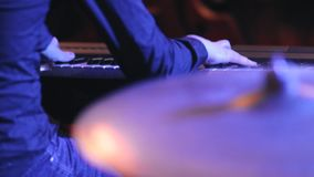 The jazz band plays music at the concert. The hands of musicians close up stock video