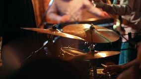Jazz band`s music game, in the foreground drummer with drums. Close up stock video