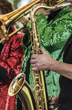 Jazz Band. In shiny jackets with saxophonist in foreground Stock Photo