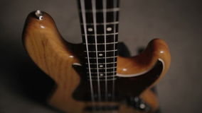 Jazz bass guitar body in light wooden color. With red pickguard and two single pickups. Smooth motion. stock video