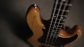 Jazz bass guitar body in light wooden color. With red pickguard and two single pickups. Smooth motion. stock video footage