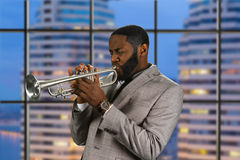 Jazz club in the city. Professional trumpet musician. Jazz club in the city. The sound of trumpet. Trumpeter's evening performance Royalty Free Stock Photography