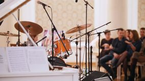 A jazz concert in the concert hall. Piano and drum kit on the background stock footage