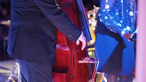 A jazz concert in the concert hall. A man playing cello stock footage