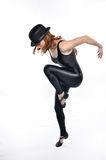 Jazz Dance Move. Jazz dancer wearing hat makes a move Royalty Free Stock Image