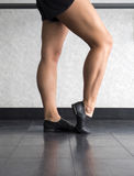 Jazz dancer at the barre with foot in dig. During jazz class in the dance studio stock images