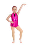 Jazz Dancer Girl in Pink on White Background. Preteen Acro Jazz Dancer Poses in Pink Recital Costume on White Background Stock Photos
