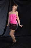 Jazz dancer in pink. A dancer posed standing in a jazz costume Stock Image