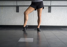 Jazz dancer pose with foot in dig Royalty Free Stock Images