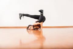Jazz dancer upside down in dance floor Royalty Free Stock Images
