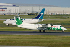 Jazz Dash 8 and Westjet 737 Stock Photo