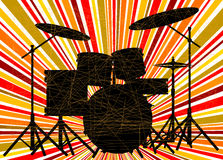 Jazz Drum Kit. Silhouette of a rock bands drum kit over a ray splash grunge background Stock Images