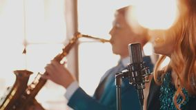 Jazz duet perform in restaurant. Singer. Saxophonist. Retro style. Spotlights stock video