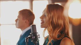 Jazz duet perform in restaurant. Vocalist. Saxophonist. Retro style. Spotlights. Music band stock footage