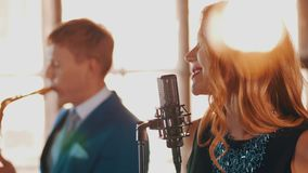 Jazz duet on stage restaurant. Vocalist. Saxophonist. Retro style. Spotlights. Music band stock footage