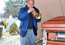 Jazz funeral. African american jazz trumpet player performing at a musician funeral Royalty Free Stock Photography