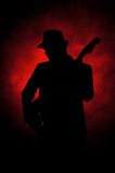 Jazz guitar. Man playing guitar with red background royalty free stock images