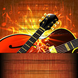 Jazz guitar close-up on a brilliant music sheet frame Royalty Free Stock Images