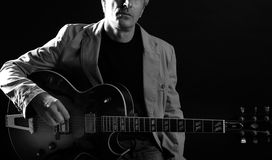 Jazz guitar player playing instrument Stock Photography