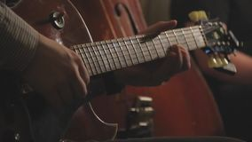 Jazz guitar trio playing on stage stock video