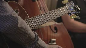 Jazz guitar trio playing on stage stock video footage