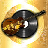Jazz guitar and a vinyl disc on a background of gold Stock Photography