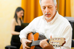 Jazz guitarist. With a female pianist Stock Photos