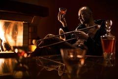Jazz man is degustating expansive cognaq royalty free stock photos