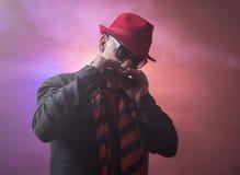 Jazz man with a harmonica Royalty Free Stock Photo