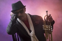 Jazz man with a trumpet Royalty Free Stock Image