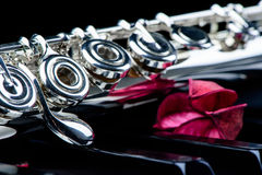 Jazz music instrument flute close up with flower. Isolated on black background Royalty Free Stock Photos