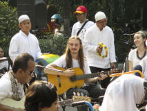 Jazz music. Ian was playing music on the streets in the city of Solo, Central Java, Indonesia Stock Photo