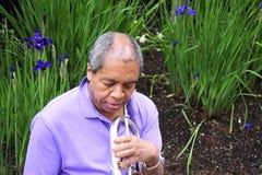 Jazz musician blowing. Stock Photos