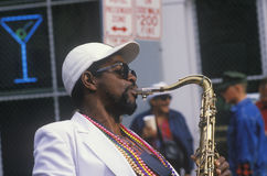 Jazz musician performing on the French Quarter, New Orleans at Mardis Gras, LA Royalty Free Stock Photo