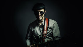 Jazz Musician Playing a Guitar Royalty Free Stock Photography