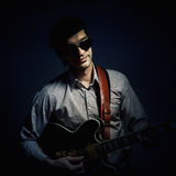 Jazz Musician Playing a Guitar Stock Images
