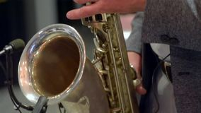 Jazz musician playing the saxophone. Jazz musician plays the saxophone, close-up stock footage