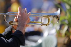 Jazz musician plays his shining trumpet. The jazz musician plays his shining trumpet Royalty Free Stock Photo