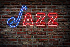 Jazz neon sign. Glowing neon jazz sing on a brick wall Stock Photos