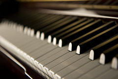 Jazz Piano Keys. Closeup photo of piano keys, focused on one note, with foreground and background fading into the distance