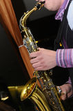 Jazz Saxophone Player. Man's hands playing jazz saxophone, photographed in close-up Royalty Free Stock Photography