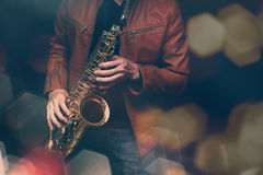 Jazz saxophone player. In performance on the stage. color filter and hexagon bokeh added Stock Photography