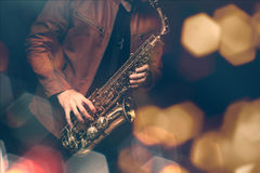 Jazz saxophone player. In performance on the stage. color filter and hexagon bokeh added Stock Image
