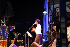 Jazz singer. On outdoor stage clapping hand, motion blur my long exposure Royalty Free Stock Images