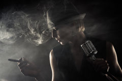 Jazz singer with cigar and microphone Stock Photography