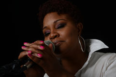 Jazz Singer. Nice image of a Jazz Singer On Black Stock Photo
