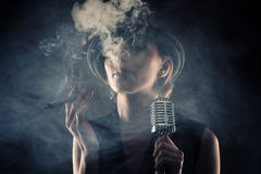 Jazz singer woman with cigar and microphone Stock Images