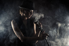 Jazz singer woman with retro microphone Royalty Free Stock Images